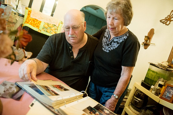 Globe/Roger Nomer<br /> Mike and his mother Delores Wilkerson look over photos in a family album on Friday.