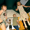 From the left: Mariah Lingenfelter, 5, Erick Greenstreet, 5, Cal Fisher, 5 and Phoebe Estes, 6, enjoy a round in a bounce house - one of many perks of attending summer school in the Sarcoxie district.<br /> Globe | Laurie Sisk