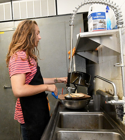 Jack Wesley mans the dishwashing station on Wednesday afternoon at Fortune East Asian Restaurant.<br /> Globe | Laurie Sisk