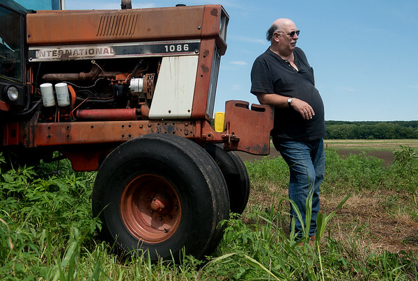 Globe/Roger Nomer<br /> Mike Wilkerson leans on his tractor as he talks about his time in a mental hospital during an interview on Friday at his home in Avila.