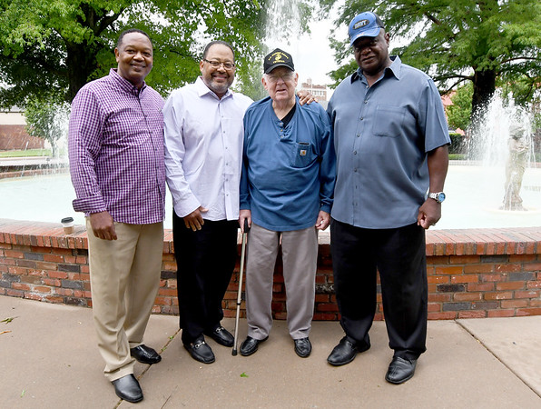 From the left: Kenric Conway, Damon Clines, Bud Morgan and Willie Williams pose for a photo after a recent reunion of Missouri Southern's Afro-American Society, which was formed in the mid-70s. Morgan, a former professor at MSSU, encouraged the former MSSU football players to form the organization, which among other accomplishments, convinced the city to rename Broadway into Langston Hughes Boulevard.<br /> Globe | Laurie Sisk