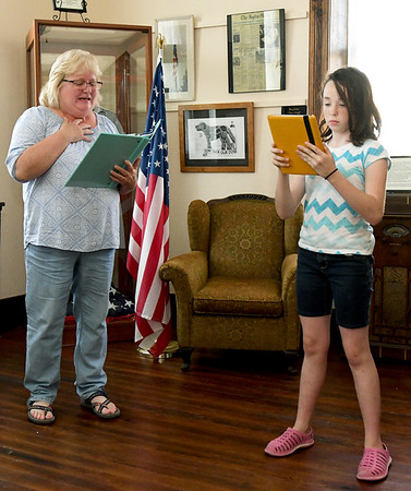 "From the left: Prospective cast members Gayla Baker and Leanna Schlessman, 10, auditions for ""Snake County Stories"" on Thursday night at the McDonald County Historic Courthouse. Organizers hope the oral history, which has been presented in the past, will become an annual event.<br /> Globe 