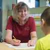 Globe/Roger Nomer<br /> Kathryn Johnson, literacy support teacher, works with a student on Wednesday at Soaring Heights Elementary.
