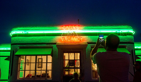Globe/Roger Nomer<br /> Dean Kennedy, Albuquerque, N.M., takes a photo of the relit neon on Saturday at the Boots Court.