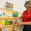 Globe/Roger Nomer<br /> Jen Black, executive director of The Alliance of Southwest Missouri, stocks books in the Wonderland Library on Friday at the Neosho Health Department.