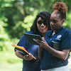 Globe/Roger Nomer<br /> Michelle Olivo, left, and Mary Smith, disaster survivor assistant specialists with FEMA, consult on Tuesday while working in Brooklyn Heights.