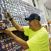 Globe/Roger Nomer<br /> Larry Miller stocks fireworks on Monday at Central City Fireworks.