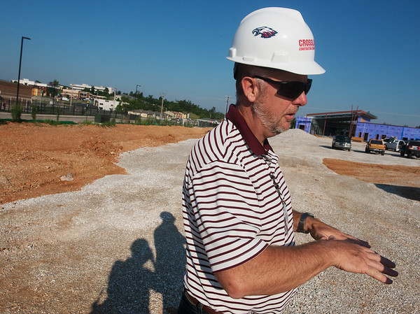Globe/Roger Nomer<br /> Dave Pettit, facilities director for the Joplin School District, talks about construction at the new Early Childhood Development Center during a tour on Thursday.