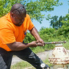 Globe/Roger Nomer<br /> Carze Brown, assitant director of public works in Carterville, tests the water pressure of a hydrant on Friday.