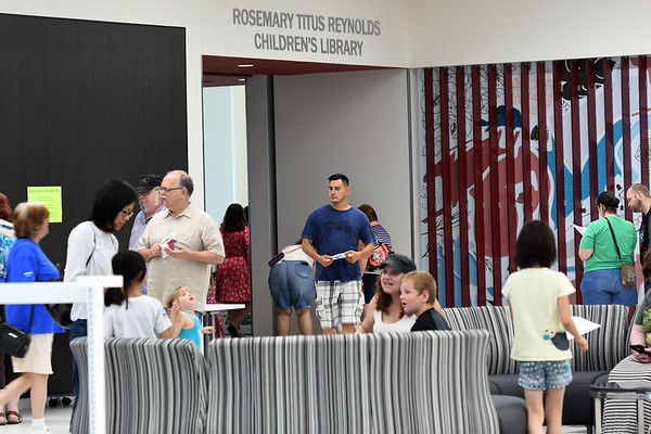 Patrons check out the facilities s they roam the lobby of the new Joplin Public Library on Saturday. An estimated 400 people attended the ribbon cutting ceremonies for the library at 20th and Connecticut streets.<br /> Globe | Laurie Sisk
