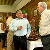 Joplin Downtown YMCA CEO Cookie Estrada, left, chats with YMCA Board Member Kevin Welch on Wednesday afternoon at a reception ahead of the closing of the location.<br /> Globe | Laurie Sisk