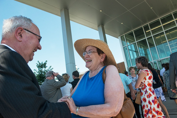 Globe/Roger Nomer<br /> Rudy Farber is congratulated by Virginia Rowland-Hogan, Joplin, after Tuesday's ribbon cutting of the JKansas City University of Medicine and Biosciences Farber-McIntire Campus. The two went to school together in Neosho.