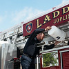 Globe/Roger Nomer<br /> Levi Sack, driver engineer with the Joplin Fire Department, transfers water into the new truck on Monday at the Main Street fire station.