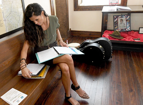 "Director Natasha O'Brien-Davis checks her notes before auditions for ""Snake County Stories"" on Thursday night at the McDonald County Historic Courthouse. Organizers hope the oral history, which has been presented in the past, will become an annual event.<br /> Globe 