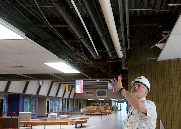 Globe/Roger Nomer<br /> Craig Grosser, project manager with Trane, talks about HVAC work going on at Pittsburg High School during a media tour on Thursday.