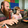 Timothy Lenze and his three-year-old daughter, Aislee Lenze explore educational games in the children's computer lab on Thursday afternoon at the Joplin Public Library.<br /> Globe | Laurie Sisk