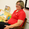 Globe/Roger Nomer<br /> Jen Black, executive director of The Alliance of Southwest Missouri, talks about the books in the Wonderland Library on Friday at the Neosho Health Department.