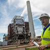 Globe/Roger Nomer<br /> Drew Landoll, manager of strategic planning for Empire District, talks about demolition of the Riverton plant's tower and boiler building during a media tour on Thursday.
