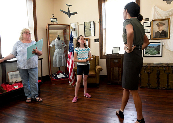 """Director Natasha O'Brien-Davis chats with prospective cast members Gayla Baker and Leanna Schlessman, 10, during auditions for """"Snake County Stories"""" on Thursday night at the McDonald County Historic Courthouse. Organizers hope the oral history, which has been presented in the past, will become an annual event.<br /> Globe 