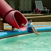 Six-year-old Henry Bresee excitedly goes down the slide at the Baxter Springs city pool grand opening on Friday. The city pool had been closed for repairs during Memorial Day weekend and will now be open everyday from 1 p.m. to 6 p.m. Admissions for children 13 and up costs $3, ages 4-12 costs $2 and children three and under swim free.   Kimberly Barker/Joplin Globe