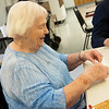 Globe/Roger Nomer<br /> Judy Coburn plays a domino game on Thursday at the Joplin Senior Center.