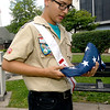 Boy Scout Troop 103 scout Michael Bowman, 15, holds a folded U.S. flag on Tuesday afternoon at Spiva Park.<br /> Globe | Laurie Sisk