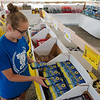 Lannie Cole, 14, Carthage, stocks fireworks at the Black Market Fireworks stand in Carthage on Monday.<br /> Globe | Roger Nomer