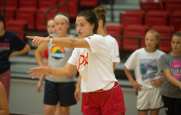 Pittsburg State freshman Syd Crain works with campers during a basketball camp at John Lance Arena on Tuesday.<br /> Globe | Roger Nomer