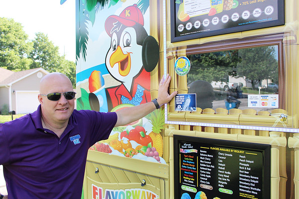 Ty Levens poses in front of his Kona Ice Joplin truck, which has been delivering flavored, colored ice to area neighborhoods since January.