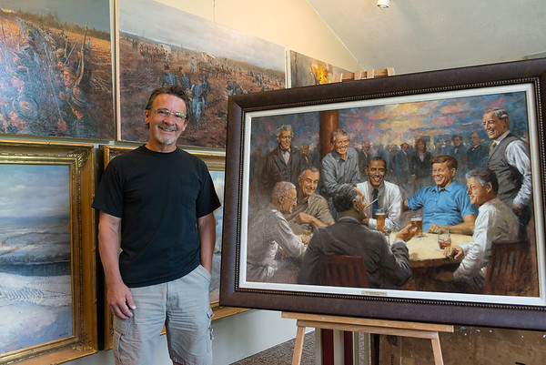 Local artist Andy Thomas has painted a woman in the background of his paintings of U.S. presidents, shown here in his Carthage studio on June 6.<br /> Globe   Roger Nomer