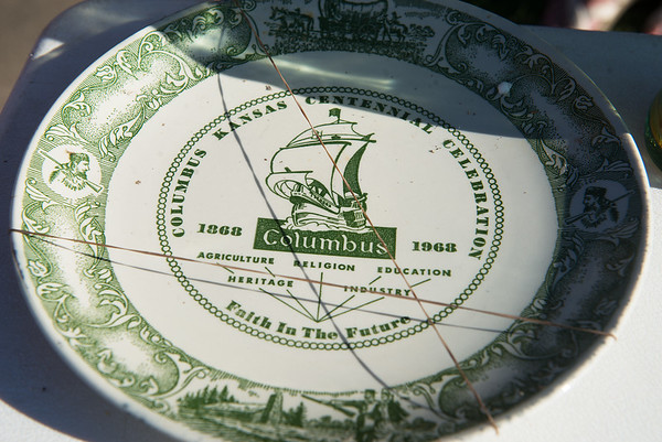 A plate from the Columbus centennial is uncovered in the 1968 time capsule.<br /> Globe   Roger Nomer