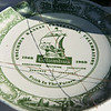 A plate from the Columbus centennial is uncovered in the 1968 time capsule.<br /> Globe | Roger Nomer
