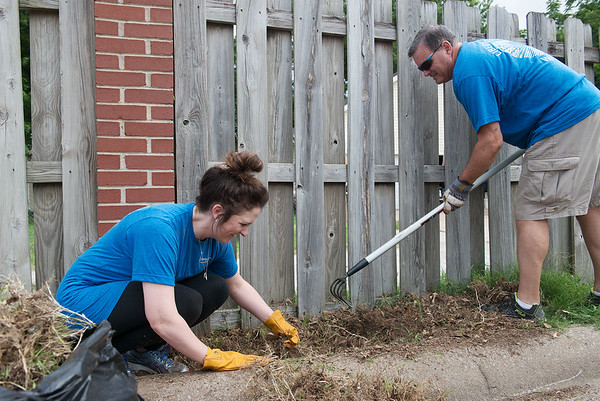 Courtney Whitehead and Richard Roark, with Liberty Utilities, work at Cerebral Palsy Center of Tri-County on Friday as part of the United Way Day of Caring.<br /> Globe   Roger Nomer