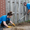 Courtney Whitehead and Richard Roark, with Liberty Utilities, work at Cerebral Palsy Center of Tri-County on Friday as part of the United Way Day of Caring.<br /> Globe | Roger Nomer