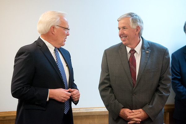 Karl Glassman, President and CEO at Leggett & Platt Inc., left, introduces Missouri Gov. Mike Parson during a visit to Flex-O-Laters in Carthage on Tuesday.<br /> Globe   Roger Nomer
