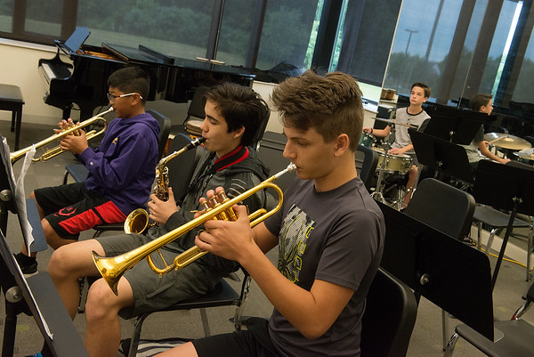 (from left) Jack Tyrrell, 12, Joplin, Desi Hix, 15, Carl Junction, Cain Butcher, 13, Carthage, and Jack Stefanoni, 13, Pittsburg, rehearse a number during Jazz Camp at Thomas Jefferson Independent Day School on Tuesday. The campers will give performances on Wednesday at Gusano's Chicago Style Pizzeria at 5 p.m. and on Thursday at Joplin Avenue Coffee at 6 p.m.<br /> Globe | Roger Nomer