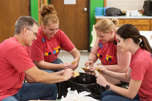 (from left) Joel Maneval, Ellen Hance, Nicole Amos and Kelsie McGarrah, with Arvest Bank work at Cerebral Palsy Center of Tri-County on Friday as part of the United Way Day of Caring.<br /> Globe | Roger Nomer