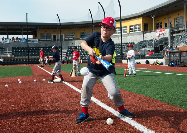 Caleb Meinershagen, 8, Webb City, practices bunting at the Joplin Outlaws Youth Camp on Wednesday at Joe Becker Stadium.<br /> Globe   Roger Nomer