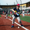 Caleb Meinershagen, 8, Webb City, practices bunting at the Joplin Outlaws Youth Camp on Wednesday at Joe Becker Stadium.<br /> Globe | Roger Nomer