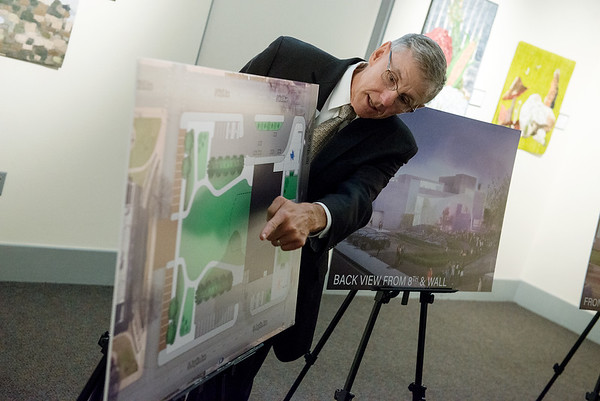 Clifford Wert, president and CFO of Connect2Culture, talks about the design of the proposed Cornell Complex on Friday at the Spiva Center for the Arts.<br /> Globe   Roger Nomer