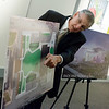 Clifford Wert, president and CFO of Connect2Culture, talks about the design of the proposed Cornell Complex on Friday at the Spiva Center for the Arts.<br /> Globe | Roger Nomer
