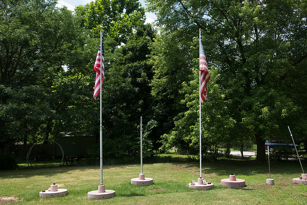 Charles Surgi sells flag poles and bases from his home in Joplin.<br /> Globe | Roger Nomer