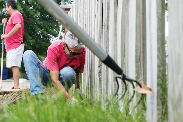 Joline DeCoster, with Freeman Health System, works at Cerebral Palsy Center of Tri-County on Friday as part of the United Way Day of Caring.<br /> Globe | Roger Nomer