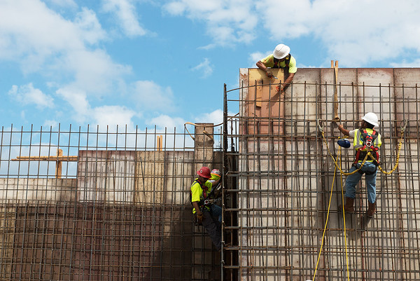 Workers construct concrete walls at Nixon Hall on Monday at Missouri Southern.<br /> Globe   Roger Nomer