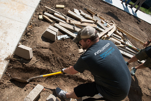 Alex Allan, an engineer with HE Williams, volunteers with Habitat for Humanity on Thursday in Carthage.<br /> Globe   Roger Nomer
