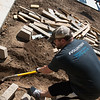 Alex Allan, an engineer with HE Williams, volunteers with Habitat for Humanity on Thursday in Carthage.<br /> Globe | Roger Nomer