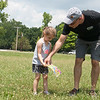 Chris Pistole, conservation and education coordinator with the Wildcat Glades Friends Group, helps Ellie Rivers, 4, Joplin, with a scavenger hunt on Wednesday at Wildcat Glades.<br /> Globe | Roger Nomer