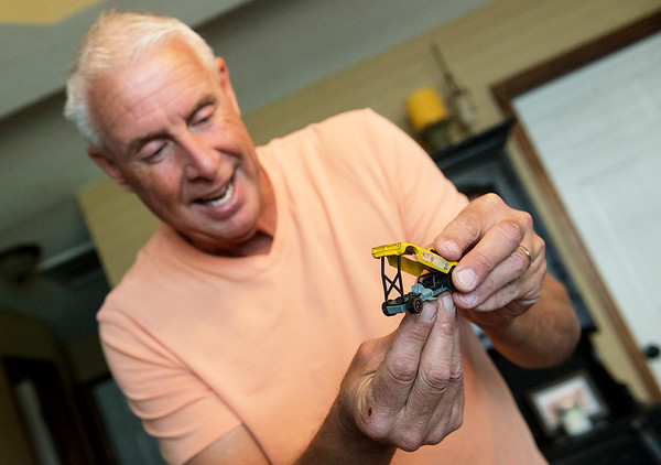 Jay McBee talks about the unique features of a Hotwheels drag racing car in his collection on Tuesday.<br /> Globe | Roger Nomer