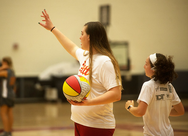 Pittsburg State freshman Megan Scott works with campers during a basketball camp at John Lance Arena on Tuesday.<br /> Globe   Roger Nomer