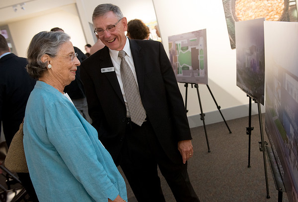 Cynthia Schwab and Clifford Wert, president and CFO of Connect2Culture, look at plans for the proposed Cornell Complex on Friday at the Spiva Center for the Arts.<br /> Globe | Roger Nomer